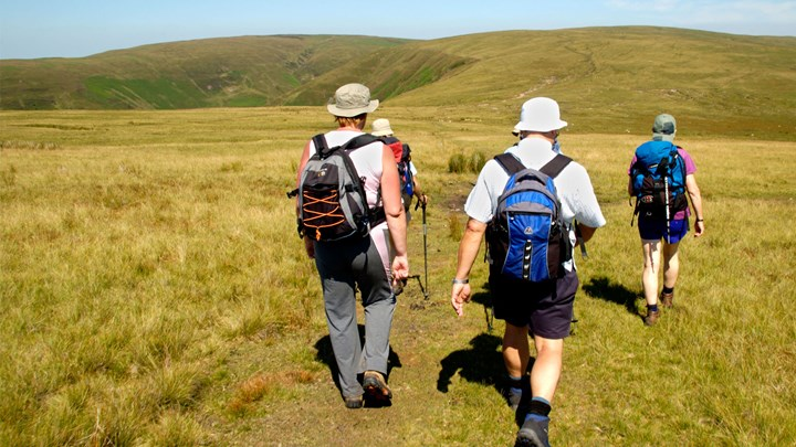 group of people out walking across hills